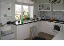 Кухня на заказ 12 нашего производства с деревянными фасадами